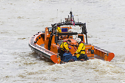 Westminster, London, March 29th 2017. A man, still believed to be alive, is pulled by RNLI rescuers from the River Thames. It is not known if the man is the one who is reported to have jumped earlier.