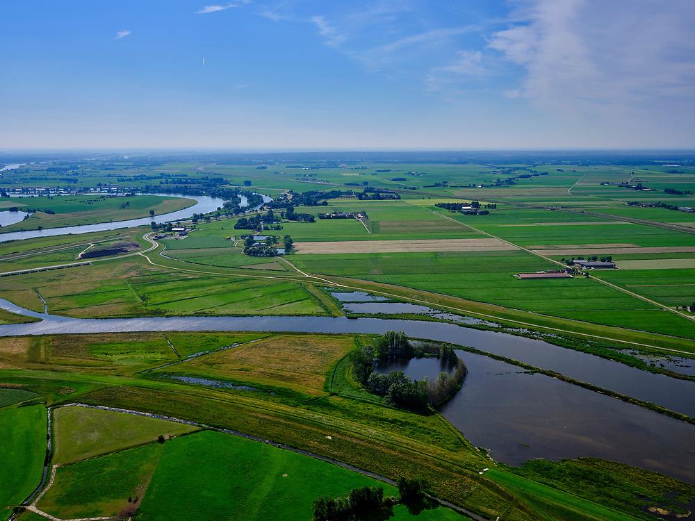 """Nederland, Overijssel, Gemeente Kampen; 21–06-2020; het Reevediep ter plaatse van De Koerskolk. Voor de aanleg van het Reevediep liep ter hoogte van dit natuurgebied in Kamperveen het riviertje Reeve.<br /> Het Reevediep is aangelegd in het kader van het project Ruimte voor de Rivier om bij hoogwater water af te voeren voordat dit het nabij gelegen Kampen bereikt, direct naar het IJsselmeer, de 'bypass Kampen'. Het Reevediepgebied is ook een natuurgebied en vormt een ecologische verbindingszone tussen rivier de IJssel en Drontermeer.<br /> Reevediep, nature reserve Koerskolk. <br /> The Reevediep has been constructed as part of the Room for the River project, and functions to discharge high waters before reaching the nearby Kampen, directly to the IJsselmeer, the """"bypass Kampen"""". The Reevediep area is also a nature reserve and forms an ecological connecting zone between the river IJssel and Drontermeer.<br /> <br /> luchtfoto (toeslag op standaard tarieven);<br /> aerial photo (additional fee required)<br /> copyright © 2020 foto/photo Siebe Swart"""