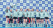 Putney, London, Varsity Boat Race, 07/04/2019, CUWBC, Presedent Abagail PARKER, holds the Trophy Aloft as the crew  celebrate winning the 2019 Oxford V Cambridge, Women's Race, Championship Course,<br /> [Mandatory Credit: Patrick WHITE], Sunday,  07/04/2019,  3:45:31 pm, Crew:  Trica SMITH, <br /> Sophie DEANS,<br /> Laura FOSTER, <br /> Larkin SAYRE, <br /> Kate HORVAT, <br /> Pippa WHITTAKER, <br /> Ida Gerte JACOBSEN, <br /> Lily LINDSAY<br /> Cox, Hugh SPAUGHTON