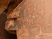 Native Americans created the petroglyphs at Atlatl Rock over 4000 years ago. The art reflects their thoughts, but we can only guess at their meaning. Valley of Fire State Park, dedicated in 1935, is the oldest state park in Nevada. Starting more than 150 million years ago, great shifting sand dunes during the age of dinosaurs were compressed, uplifting, faulted, and eroded to form the park's fiery red sandstone formations. The park also boasts fascinating patterns in limestone, shale, and conglomerate rock. The park adjoins Lake Mead National Recreation Area at the Virgin River confluence, at an elevation of 2000 to 2600 feet (610-790 m), 50 miles (80 km) northeast of Las Vegas, USA. Park entry from Interstate 15 passes through the Moapa Indian Reservation.