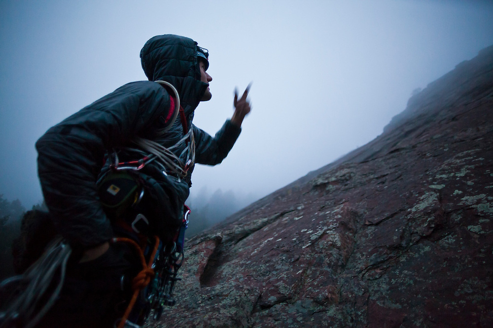 Obadiah Reid looks up at his climbing route on the First Flatiron (Direct East Face, 5.6) above Boulder, Colorado.