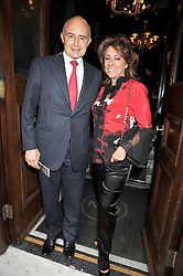 ROGER MOSS and SUSAN BERNERD at the relaunch party of No.11 - the hotel and Private members club, 11 Cadogan Gardens, London on 4th June 2009.