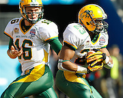 North Dakota State Bison quarterback Brock Jensen (16) hands the ball off to North Dakota State Bison running back John Crockett (23) during the FCS title game against Sam Houston State at FC Dallas Stadium in Frisco, Texas, on January 5, 2013.  (Stan Olszewski/The Dallas Morning News)
