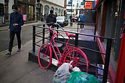 Bicycle sprayed cerise pink in Soho, London, UK.