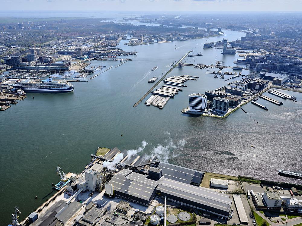 Nederland, Noord-Holland, Amsterdam; 16-04-2021; in de voorgrond Coenhaven met aan de Fosfaatweg  ICL Fertilizers Europe. Zicht op de Danzigerkade (rechts) en Damen Shiprepair AmsterdamTt. Vasumweg (links). IJ met IJ-oevers, Overhoeks en Houthavens.<br /> In the foreground Coenhaven with ICL Fertilizers Europe on the Fosfaatweg. View of the Danzigerkade (right) and Damen Shiprepair Amsterdam Tt. Vasumweg (left). IJ with IJ banks, Overhoeks and Houthavens.<br /> <br /> luchtfoto (toeslag op standard tarieven);<br /> aerial photo (additional fee required)<br /> copyright © 2021 foto/photo Siebe Swart