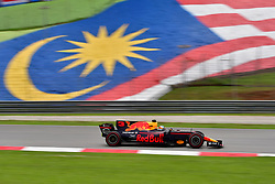 SEPANG, Oct. 1, 2017  Red Bull driver Daniel Ricciardo of Australia drives at the Formula One Malaysia Grand Prix at the Sepang Circuit in Malaysia, on Oct. 1, 2017. Max Verstappen claimed the title of the event. (Credit Image: © Chong Voon Chung/Xinhua via ZUMA Wire)