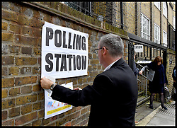 June 8, 2017 - London, London, United Kingdom - Image ©Licensed to i-Images Picture Agency. 08/06/2017. London, United Kingdom. Polling Day. A polling station inspector places a polling station poster up outside a polling station in Islington as the UK goes to the polls in the 2017 General Election.Picture by Andrew Parsons / i-Images (Credit Image: © Andrew Parsons/i-Images via ZUMA Press)