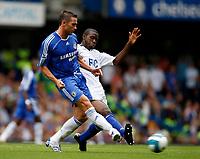 Photo: Richard Lane/Sportsbeat Images. <br />Chelsea v Birmingham. Barclay's Premiership. 12/08/2007. <br />Chelsea's Frank Lampard is challenged by Birmingham's Fabrice Muamba.