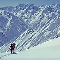 SKI MOUNTAINEERING, Great Himalaya Range, India. Jay Jensen (MR) atop Gulol Pass,  during ski mountaineering expedition across Himalaya from Ladakh to Kashmir.