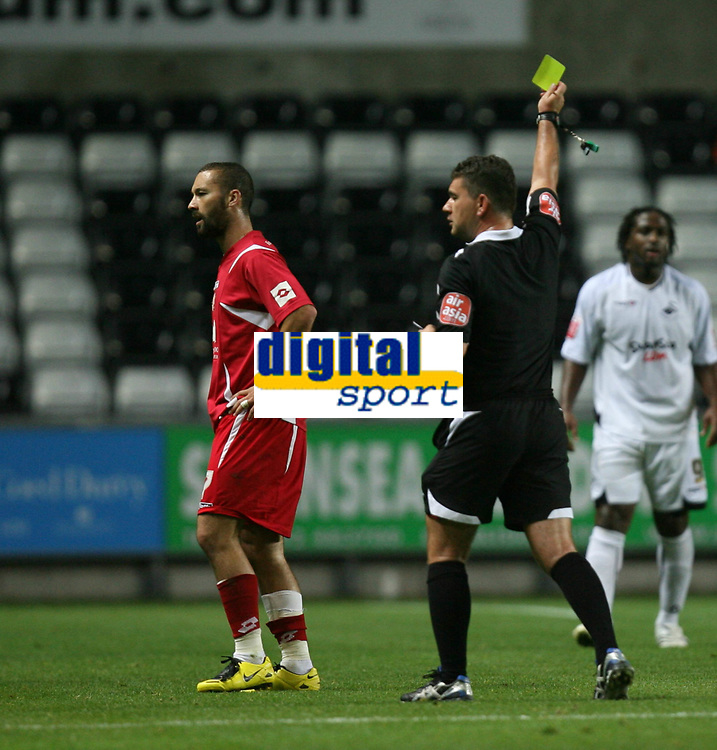 Photo: James Davies.<br />Swansea City v Swindon Town. Coca Cola League 1. 02/10/2007. <br />Swindon`s Christian Roberts gets a yellow card from referee D McDermid.