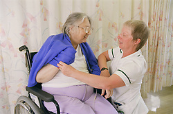 Occupational Therapy session with patient learning one handed dressing technique following stroke affecting the left side,