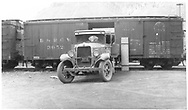 """Box car #3052 with GMC truck in Silverton, CO.<br /> D&RGW  Silverton, CO  Taken by Prosser, - 1934<br /> In book """"Narrow Gauge Pictorial, Vol. III: Gondolas, Boxcars and Flatcars of the D&RGW"""" page 108"""
