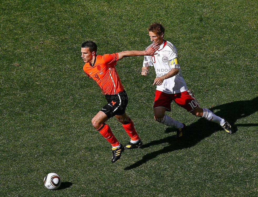 14-06-2010 VOETBAL: FIFA WORLDCUP 2010 NEDERLAND - DENEMARKEN: JOHANNESBURG<br /> Robin Van Persie in action with Martin Jorgensen of Denmark<br /> ©2010-FRH- NPH/  Mark Atkins (Netherlands only)
