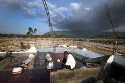 Hassan Ali sits amidst the destruction of what was once his family home.  His entire family was destroyed in the tsunami, wife and all his children, his mother and father, cousins, brothers, sisters.  He was at sea at the time, fishing, and when I was able to find his way back there was nothing to be found.