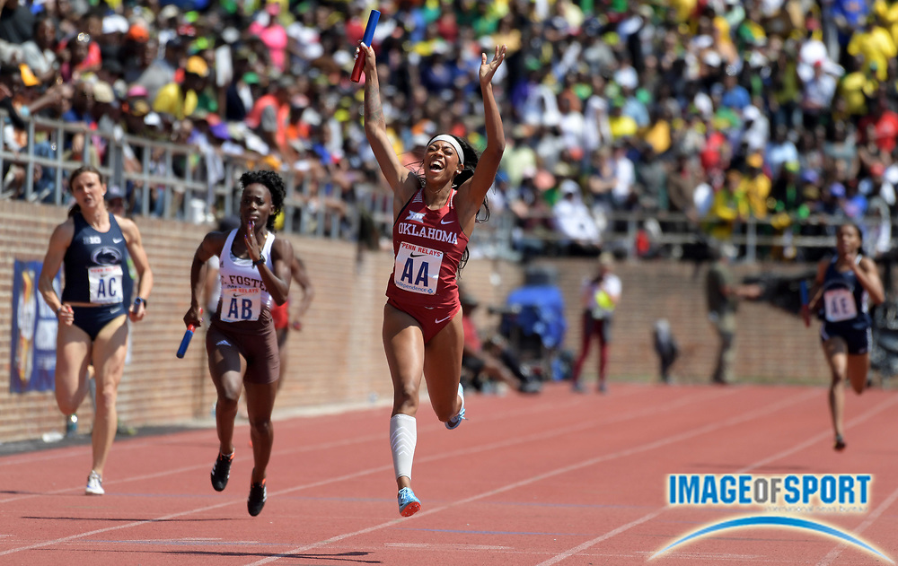 Apr 28, 2018; Philadelphia, PA, USA; Medinah Spencer celebrates after running the anchor leg on the Oklahoma women's 4 x 200m relay that won the Championship of America race in 1:32.41 during the 124th Penn Relays at Franklin Field.
