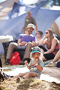 a toddler enjoys ice cream backstage at Pickathon 2012 at Pendarvis Farm in Happy Valley, OR. Photo by Jason Quigley