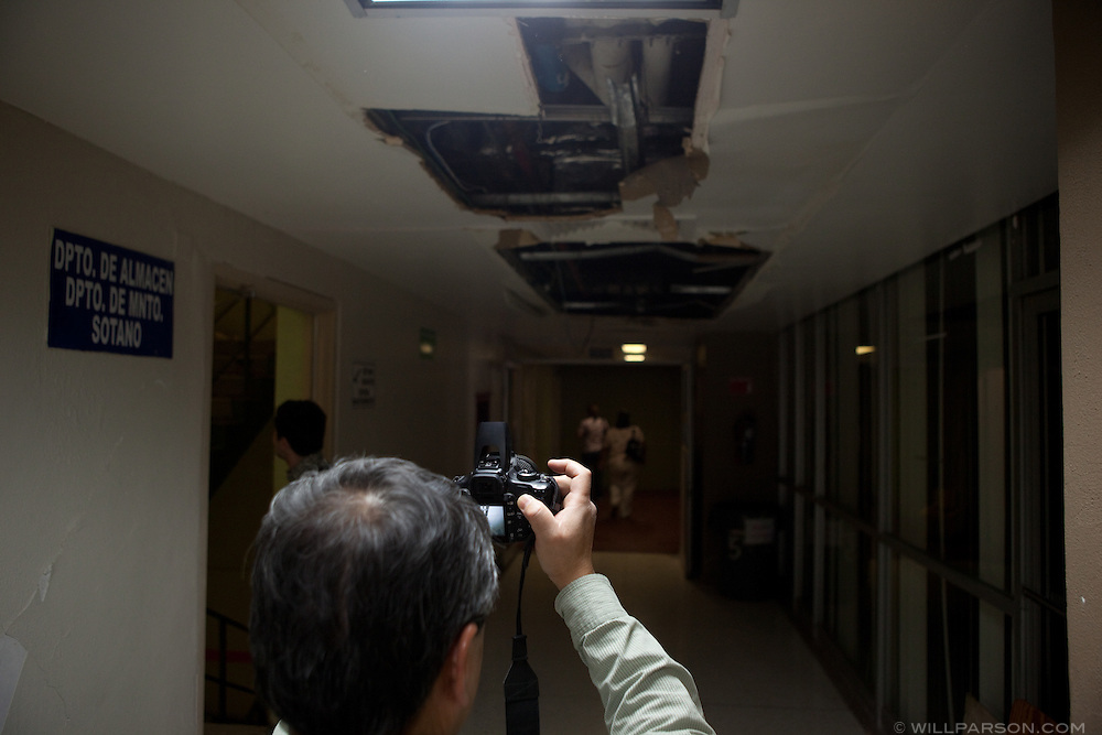Dr. Benson Shing takes a picture of a damaged ceiling inside a hospital. Researchers led by Dr. Benson Shing, Vice Chair of the Department of Structural Engineering at the University of California, San Diego, inspected the earthquake damage in Mexicali, Mexico, April 7, 2010. A 7.2 magnitude earthquake in Baja California on Easter Sunday was felt as far away as Los Angeles.