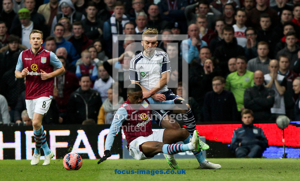 Charles N'Zogbia (centre) of Aston Villa tackles James Morrison (right) of West Bromwich Albion during the FA Cup match at Villa Park, Birmingham<br /> Picture by Tom Smith/Focus Images Ltd 07545141164<br /> 07/03/2015