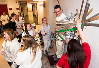 Athletic Director/Dean of Students Craig Kozens gets duct taped to the wall by Jag students to raise money for Make-a-Wish at Laconia High School on Wednesday afternoon.  (Karen Bobotas/for the Laconia Daily Sun)