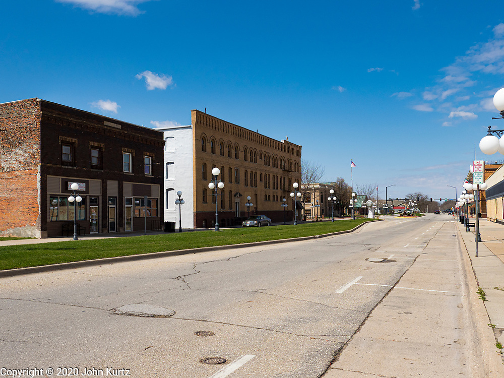 """20 APRIL 2020 - PERRY, IOWA:  An empty street in Perry, IA. The Tyson pork processing plant in Perry reported over the weekend that at least two dozen workers had tested positive for COVID-19. The plant is closed Monday, April, 20 for a thorough cleaning and sanitization. At least five meat packing plants in Iowa have reported outbreaks of COVID-19. In addition to the five plants in Iowa, meat packing plants close to Iowa in Nebraska, South Dakota, and Minnesota have reported outbreaks of COVID-19 (SARS-CoV-2, Coronavirus). The Tyson plant has more than 1,400 workers and is the largest single employer in Perry. The state of Iowa has begun providing surveillance testing of meatpacking plants to more broadly test employees even if they are not experiencing symptoms of COVID-19. State """"strike teams"""" made up of an epidemiologist, an infectious disease nurse and other personnel will advise facilities of preventative measures to take and administer contact tracing to determine who may have been in contact with any infected individual.     PHOTO BY JACK KURTZ"""