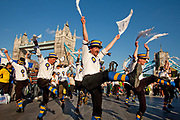 Thames Festival 2009. The Hammersmith Morris Men performing in front of Tower Bridge.