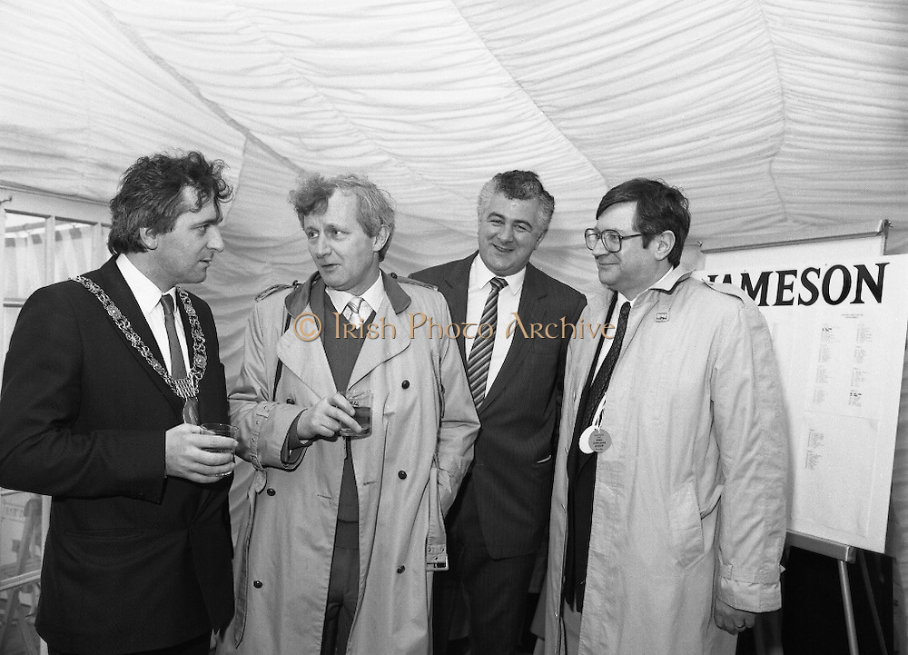Irish Grand National At Fairyhouse.  (R54)..1987..20.04.1987..04.20.1987..20th April 1987..The Easter Racing Festival at Fairyhouse included the running of the Jameson sponsored Irish Grand National. Another featured race was the Jameson Gold Cup which was also run on Easter Monday...In the sponsors tent,winning owner, Mr Jimmy Glynn celebrates his win with a glass of Jameson Whiskey. Included in the picture are Mr Bertie Ahern,Lord Mayor of Dublin, Mr Richard Burrows, Group Managing Director, Irish Distillers and Mr Ray Burke TD.