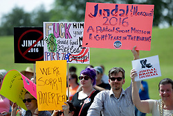 24 June 2015. Kenner, Louisiana.<br /> Protesters line the road as Governor Bobby Jindal announces his run for President of the United States during a political event at the Pontchartrain Center in Kenner, La.<br /> Photo©; Charlie Varley/varleypix.com