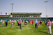 17 SEPTEMBER 2020 - DES MOINES, IOWA: New citizens during a naturalization ceremony at Principal Park, a minor league baseball stadium in downtown Des Moines. About 75 people from 32 countries were naturalized as US citizens Thursday. It was the last citizenship ceremony in Des Moines before citizenship fees dramatically increase. Starting Oct. 2, the fee to apply for U.S. citizenship will increase from $640 to $1,160 if filed online, or $ 1,170 in paper filing, a more than 80% increase in cost. Advocates for immigration are afraid the new fees will be too expensive for many immigrants and say it's an effort by the Trump Administration to limit the number of new citizens welcomed into the United States. Because of the COVID-19 pandemic, there has been dramatic slow down in the number of naturalization ceremonies this year.           PHOTO BY JACK KURTZ