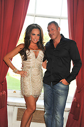 TAMARA ECCLESTONE and OMAR KHYAMI at a party to celebrate Tamara Ecclestone's 28th birthday held in Tyringham, Newport Pagnell, Bucks on15th June 2012.