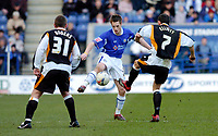 Photo: Leigh Quinnell.<br /> Leicester City v Hull FC. Coca Cola Championship. 04/03/2006. Leicesters Alan Maybury can't find a way past Hulls Alan Rogers and Stuart Elliott.