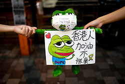 Hong Kong. 30 September, 2019. Peaceful protest held in Tsim Sha Tsui district of Kowloon tonight. Using the frog Pepe, which is a symbol of the pro-democracy movement in the city, protestors formed a human chain stretching along busy Nathan Road.  Iain Masterton/Alamy Live News.