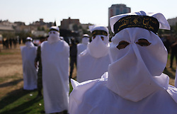 October 4, 2018 - Gaza City, Gaza Strip, Palestinian Territory - Palestinian militants from the Al-Quds Brigades, the armed wing of the Islamic Jihad movement, prepare to take part in a military march, in Gaza city.   (Credit Image: © Mahmoud Ajjour/APA Images via ZUMA Wire)