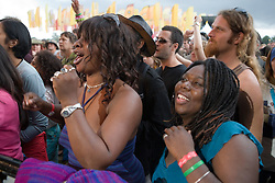 Crowd cheering band of musicians on stage at the WOMAD (World of Music; Arts and Dance) Festival in reading; 2005,
