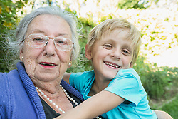 Portrait of grandmother with grandson, close-up