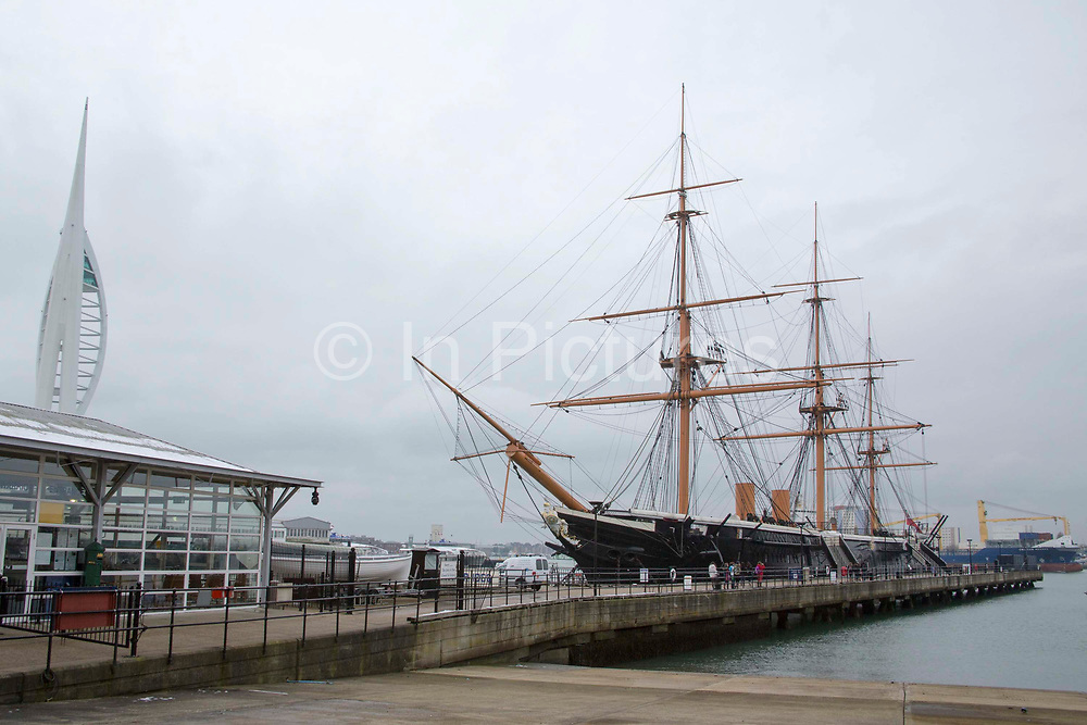 The British Royal Navy historical warship, HMS Warrior (1860) restored and moored in Portsmouth Historic Dockyard, Hampshire, UK. The ship was powered by steam and sail, and was Britain's first iron-hulled armored warship and the largest, fastest and most powerful ship of her day. She is now a ship museum, monument, visitor attraction and private venue.