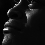 """A spectator cries, reacting while watching the inauguration ceremony of Barack Obama on jumbotron screens on the National Mall, January 20, 2009. Obama took the oath as the nation's 44th, and first African-American, President.     ltqmb   """"Faces 12"""