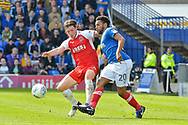 Portsmouth Defender, Nathan Thompson (20) beats Fleetwood Town Midfielder, Aiden O'Neill (4) to the ball during the EFL Sky Bet League 1 match between Portsmouth and Fleetwood Town at Fratton Park, Portsmouth, England on 16 September 2017. Photo by Adam Rivers.