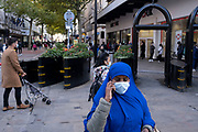 With local coronavirus lockdown measures in place and Birmingham currently set at 'Tier 2' or 'high', people, many of whom are wearing face masks as the junction of Corporation Street and New Street in the city centre on 26th October 2020 in Birmingham, United Kingdom. The three tier system in the UK has levels: 'medium', which includes the rule of six, 'high', which will cover most areas under current restrictions; and 'very high' for those areas with particularly high case numbers. Meanwhile there have been calls by politicians for a 'circuit breaker' complete lockdown to be announced to help the growing spread of the Covid-19 virus.