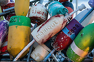 A collection of colorful lobster pot buoys on MacMillan wharf in Provincetown.