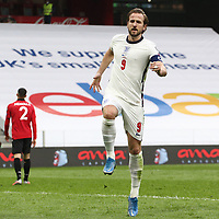 TIRANA, ALBANIA - MARCH 28: Harry Kane celebrates after opening the scoring for England during the FIFA World Cup 2022 Qatar qualifying match between Albania and England at the Qemal Stafa Stadium on March 28, 2021 in Tirana, Albania. Sporting stadiums around Europe remain under strict restrictions due to the Coronavirus Pandemic as Government social distancing laws prohibit fans inside venues resulting in games being played behind closed doors (Photo by MB Media)
