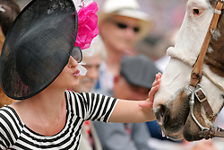 May 3, 2019 - Louisville, KY, U.S. - LOUISVILLE, KY - MAY 03: A fan pets a horse during a break in the action on Kentucky Oaks day at Churchill Downs Racetrack on May 4, 2018 in Louisville, Kentucky. (Photo by Jeffrey Brown/Icon Sportswire) (Credit Image: © Jeffrey Brown/Icon SMI via ZUMA Press)