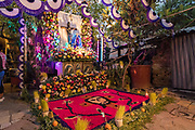 A family altar made from flowers celebrating El Viernes de Dolores during Holy Week at a home March 23, 2018 in San Miguel de Allende, Mexico. The event honors the sorrow of the Virgin Mary for the death of her son and is an annual tradition in central Mexico.