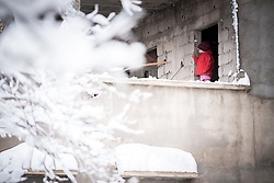 7 January 2018, Imlil, Morocco: A girl looks out the door of her home in Imlil, Morocco, after two days of heavy snowfall, the first precipitation in a month's time. Although heavy snowfall means heavy work for the villagers in cleaning up rooftops and roads, it is also a welcome contribution, as the snow helps attract tourists to the area, as well as secure water supplies to local agriculture.