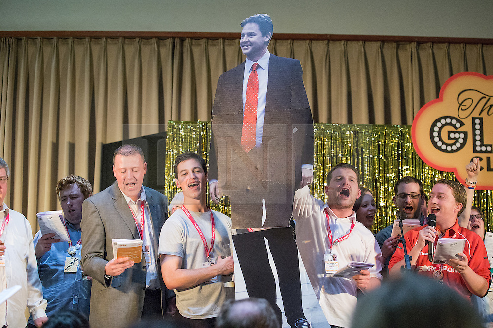 © Licensed to London News Pictures . 07/10/2014 . Glasgow , UK . Delegates dance with a cardboard cutout of Nick Clegg . Glee club fringe event overnight at the conference hotel . The Liberal Democrat Party Conference 2014 at the Scottish Exhibition and Conference Centre in Glasgow . Photo credit : Joel Goodman/LNP