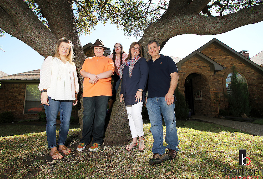 Jennifer Andrick, second from right, with her husband Tom Andrick  and her children Jessica Walker, Trevor Andrick and Allie Andrick on  Saturday, April 2, 2016 in Plano, Texas. (Photo by Kevin Bartram)