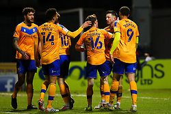 Mansfield Town players celebrate their opening goal - Mandatory by-line: Ryan Crockett/JMP - 17/02/2021 - FOOTBALL - One Call Stadium - Mansfield, England - Mansfield Town v Bolton Wanderers - Sky Bet League Two