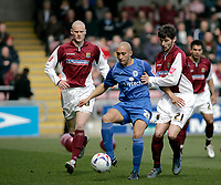 Photo: Marc Atkins.<br /> Northampton Town v Rochdale. Coca Cola League 2. 08/04/2006. <br /> Ben Kitchen (L) battles Northampton FC's Jamie Hand.