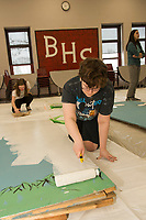 """Kelly Hayes and Emma Lacey paint new backdrops during """"Tech Day"""" for Once Upon a Mattress at Belmont High School on Saturday.  (Karen Bobotas/for the Laconia Daily Sun)"""