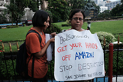 August 26, 2019, Kolkata, West Bengal, India: Activists of Save Jassore Road Trees Committee arranged a protest rally against the President of Brazil Jair Bolsonaro to protest against the fire at Amazon rain forest. Almost 60 students and activists took part in this rally. Their destination was Brazilian consulate of Kolkata. (Credit Image: © Jit Chattopadhyay/Pacific Press via ZUMA Wire)