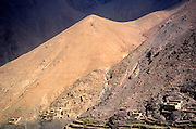 Berber village and farm terraces in mountain valley, Atlas Mountains, near Imlil, Morocco